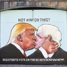 A graffiti mural of Donald Trump and Boris Johnson