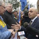 Sajid Javid - pictured talking to Tata Steel workers in Port Talbot - is due to update MPs after returning from Mumbai