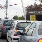 Cars queue near a poster that reads Fuel Shortage in northern France (AP)