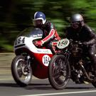 A Rudge TT Replica 500cc races against a BSA Rocket 3 Racer at the Isle of Man TT races [File photo]