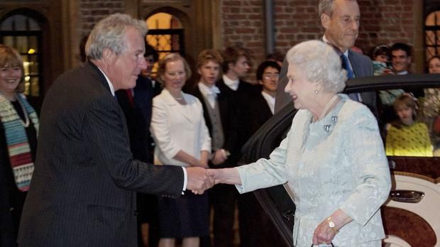 Lord Waldegrave, pictured greeting the Queen during a visit to Eton College, has threatened to quit the Tory party whip in the Lords