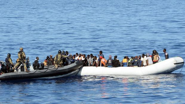 Migrants waiting to board a Royal Navy boat during an operation countering migrant smugglers last autumn