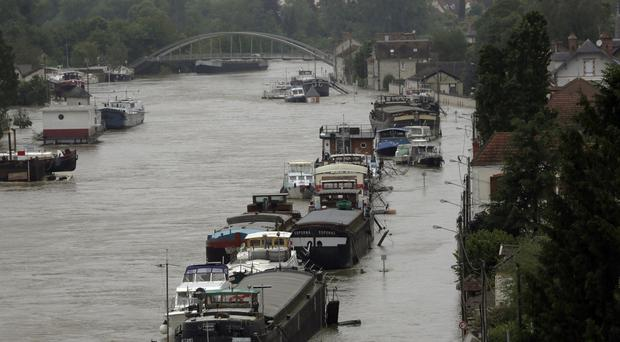 Boats on the flooded Loing Canal in St Mammes, where the Loing joins the Seine south of Paris (AP)