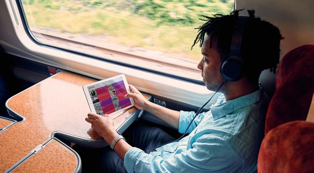 A Virgin Trains passenger uses the new entertainment system