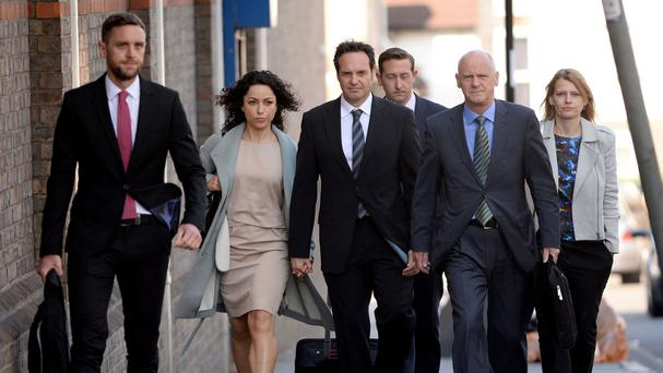 Former Chelsea FC team doctor Eva Carneiro arrives with her husband Jason De Carteret, third left, at Croydon Employment Tribunal