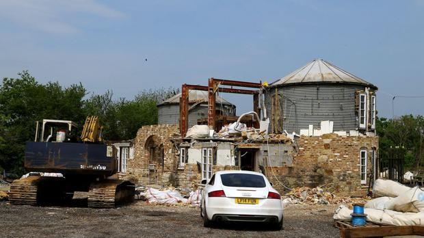Robert Fidler's mock Tudor castle in the process of being demolished