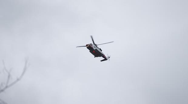 A coastguard search and rescue helicopter joined the rescue of the hiking group