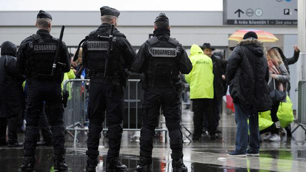 Armed police inside the stadium perimeter at the Stade de France, Paris