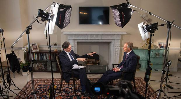 John Micklethwait, editor-in-chief of Bloomberg Editorial, speaks to former prime minister Tony Blair during a Bloomberg Television interview in London (Simon Dawson/Bloomberg/PA)