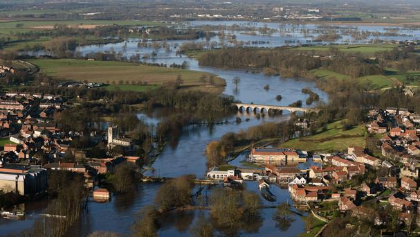 Flooding in Tadcaster, North Yorkshire, as MPs warned of a lack of long-term strategic planning to protect communities at risk