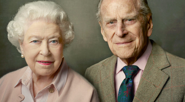 The official photograph released by Buckingham Palace shows the Queen side-by-side with husband The Duke of Edinburgh, taken at Windsor Castle just after Easter