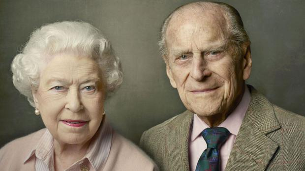 This official photograph released by Buckingham Palace to mark her 90th birthday shows the Queen with her husband, The Duke of Edinburgh, and was taken at Windsor Castle just after Easter