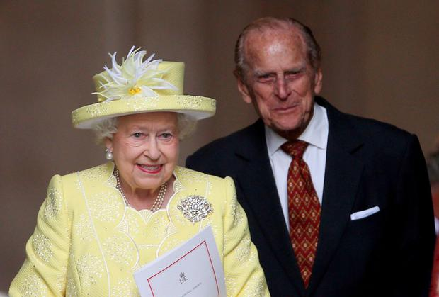 The Queen and The Duke of Edinburgh arrive at the service yesterday