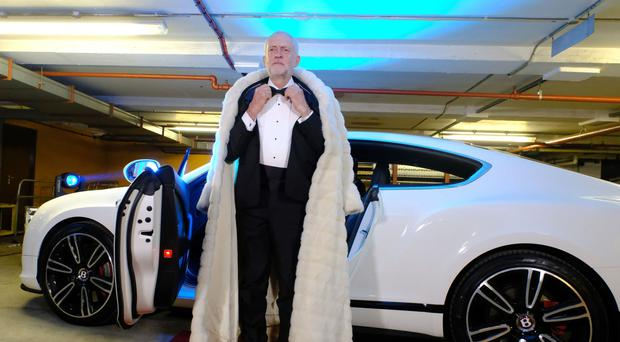 Jeremy Corbyn arrived by Bentley wearing a tuxedo and full length fake fur coat for his appearance on The Last Leg (Open Mike Productions/PA)