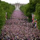 Ten thousand picnicking revellers are expected to celebrate the Queen's birthday on The Mall beneath storm clouds