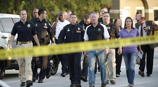 Orlando mayor Buddy Dyer, centre right, and Orlando police chief John Mina, centre left, arrive at a news conference