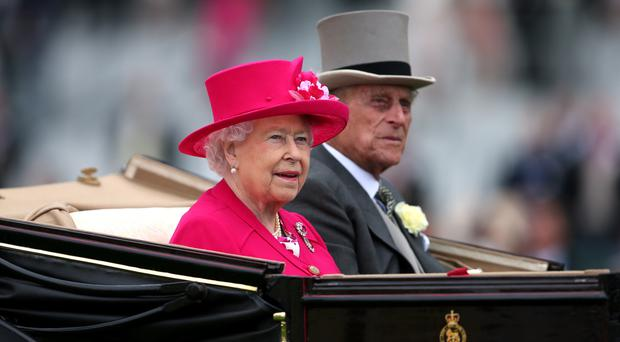 The Queen and the Duke of Edinburgh arrive for day one of the 2015 Royal Ascot Meeting at Ascot Racecourse, Berkshire