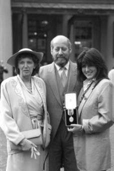Sir Clement Freud with his wife Jill (left) and daughter Emma after receiving his knighthood