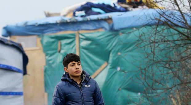 A young migrant in the so-called Calais Jungle, as a harrowing picture of abuse suffered by unaccompanied children at refugee camps emerged