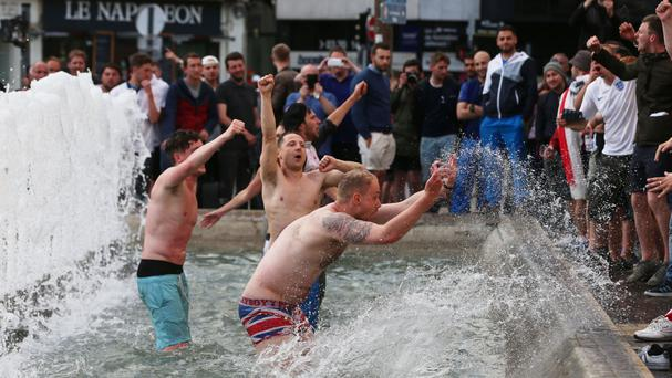 England supporters celebrate in a fountain in Lille after their Euro 2016 victory over Wales