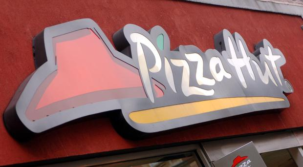 A man dragged a girl from a Pizza Hut restaurant before stabbing and raping her