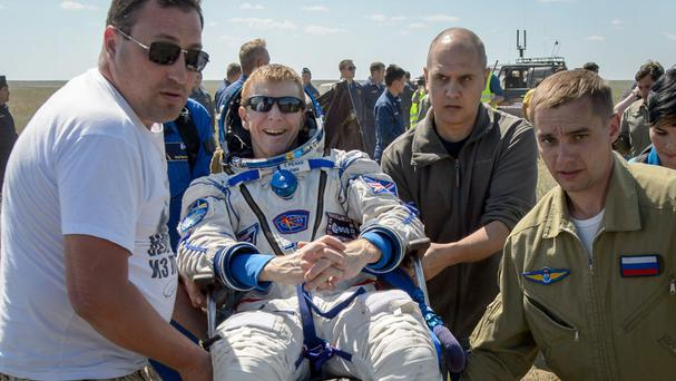 Tim Peake being carried to a medical tent after he landed in Kazakhstan (Nasa/Bill Ingalls)