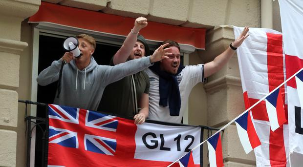England fans hang flags outside a bar in Place Jean Jaures, Saint-Etienne