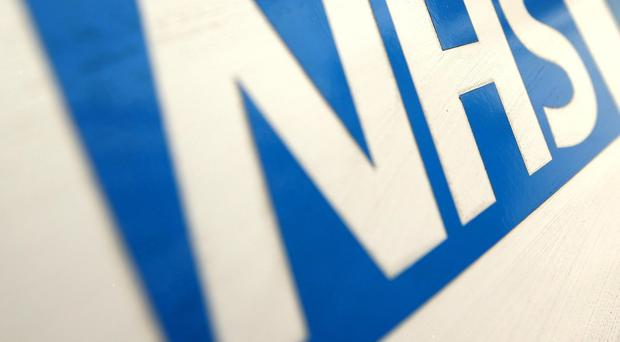 File photo of the NHS logo