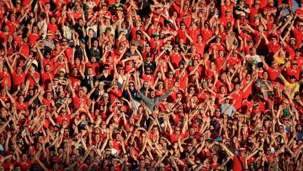 Wales fans cheer on their side in the stands during the UEFA Euro 2016, Group B match at Stadium Municipal, Toulouse
