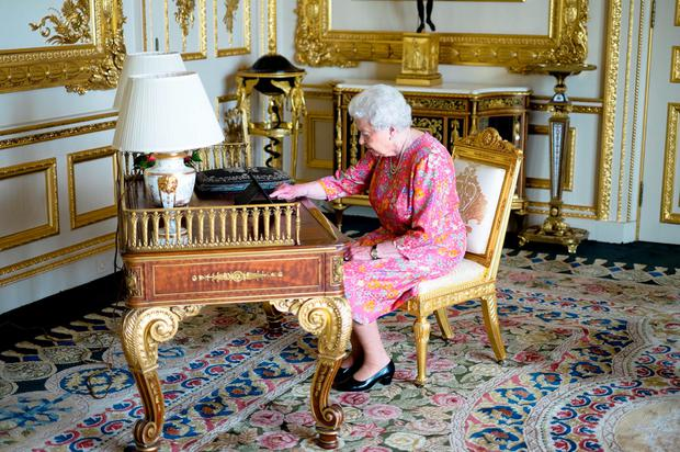 The Queen tweets on a tablet from the white drawing room at Windsor Castle to thank everyone for their birthday messages. Photo: PA