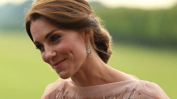 The Duchess of Cambridge greets guests attending a gala dinner at Houghton Hall in King's Lynn