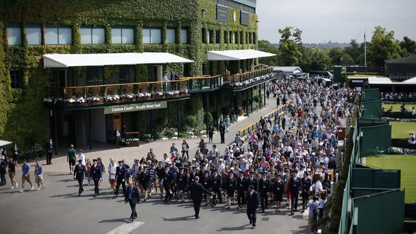 Unprecedented security, including a visible presence of armed police, will be seen at Wimbledon this year