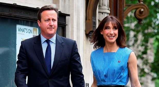 Prime Minister David Cameron and his wife Samantha arrive to cast their votes in London