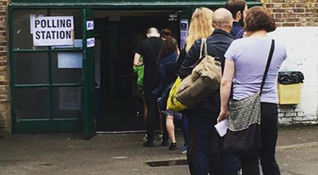 People queuing outside a polling station in Dalston, London, as voters go the polls in the EU referendum.