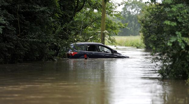 A car left stranded in a flooded road in Billericay, Essex
