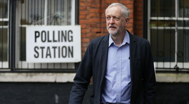 Labour Party leader Jeremy Corbyn arrives to cast his vote at a polling station in Islington