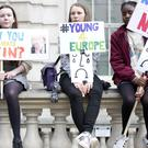 Young people protest at the gates of Downing Street.