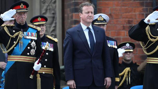 Prime Minister David Cameron watches the parade and the Duke of Kent takes the salute during Armed Forces Day at Cleethorpes, Lincolnshire