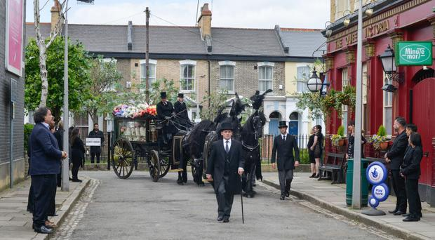 Billy Mitchell leads Peggy Mitchell's funeral procession through Albert Square (BBC/PA)