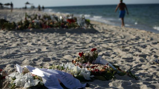 Tributes on the beach at Sousse in Tunisia after the massacre which is being marked a year on