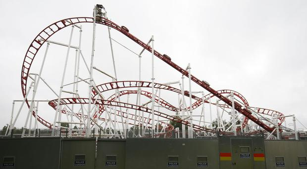 A police cordon around the Tsunami rollercoaster at M&D's amusement park in Motherwell after one of its carriages derailed
