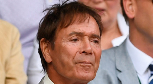 Sir Cliff Richard looks on from the stands in Centre Court on day one of Wimbledon yesterday