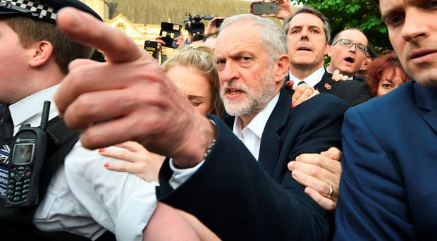 Labour leader Jeremy Corbyn arrives to speak at a rally in Parliament Square last night