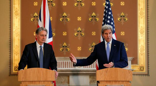 Foreign Secretary Philip Hammond (left) with US Secretary of State John Kerry after their meeting yesterday