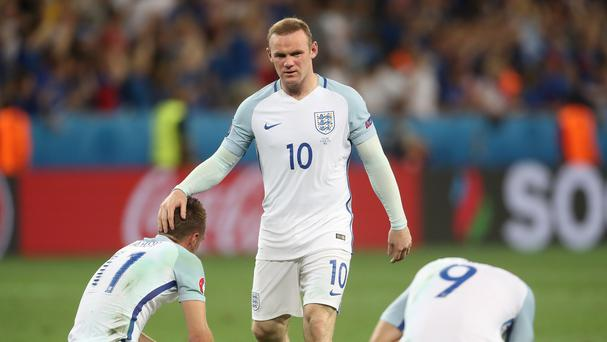 England's Wayne Rooney (centre) and his team-mates look dejected after the final whistle following the Round of 16 match at Stade de Nice