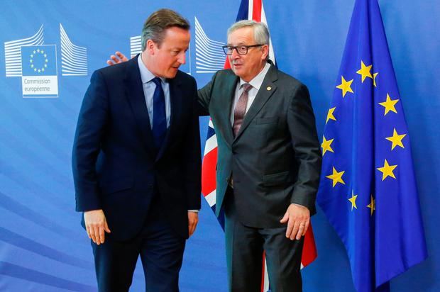 British PM David Cameron is greeted by European Commission President Jean-Claude Juncker yesterday