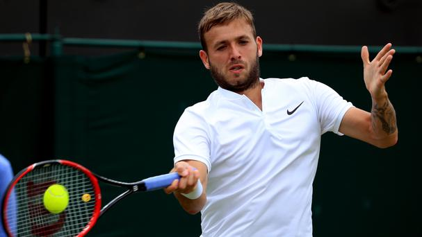 Dan Evans during his match against Alexandr Dolgopolov
