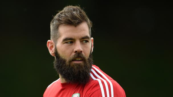 Wales midfielder Joe Ledley has postponed his wedding after the team's success at the Euros
