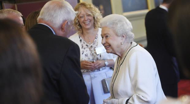 The Queen meets guests at a reception at the Palace of Holyroodhouse