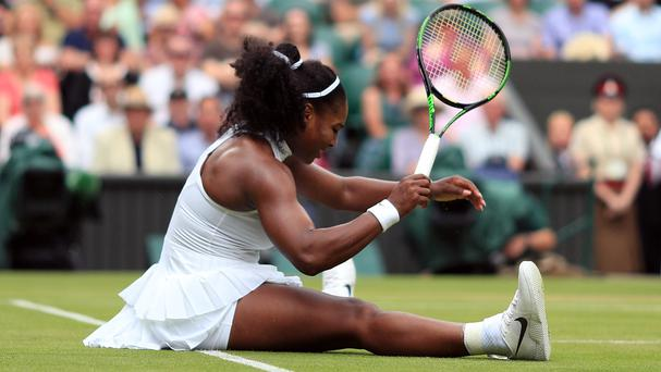 Serena Williams was frustrated after a heavy fall on a rain-dampened surface at Wimbledon